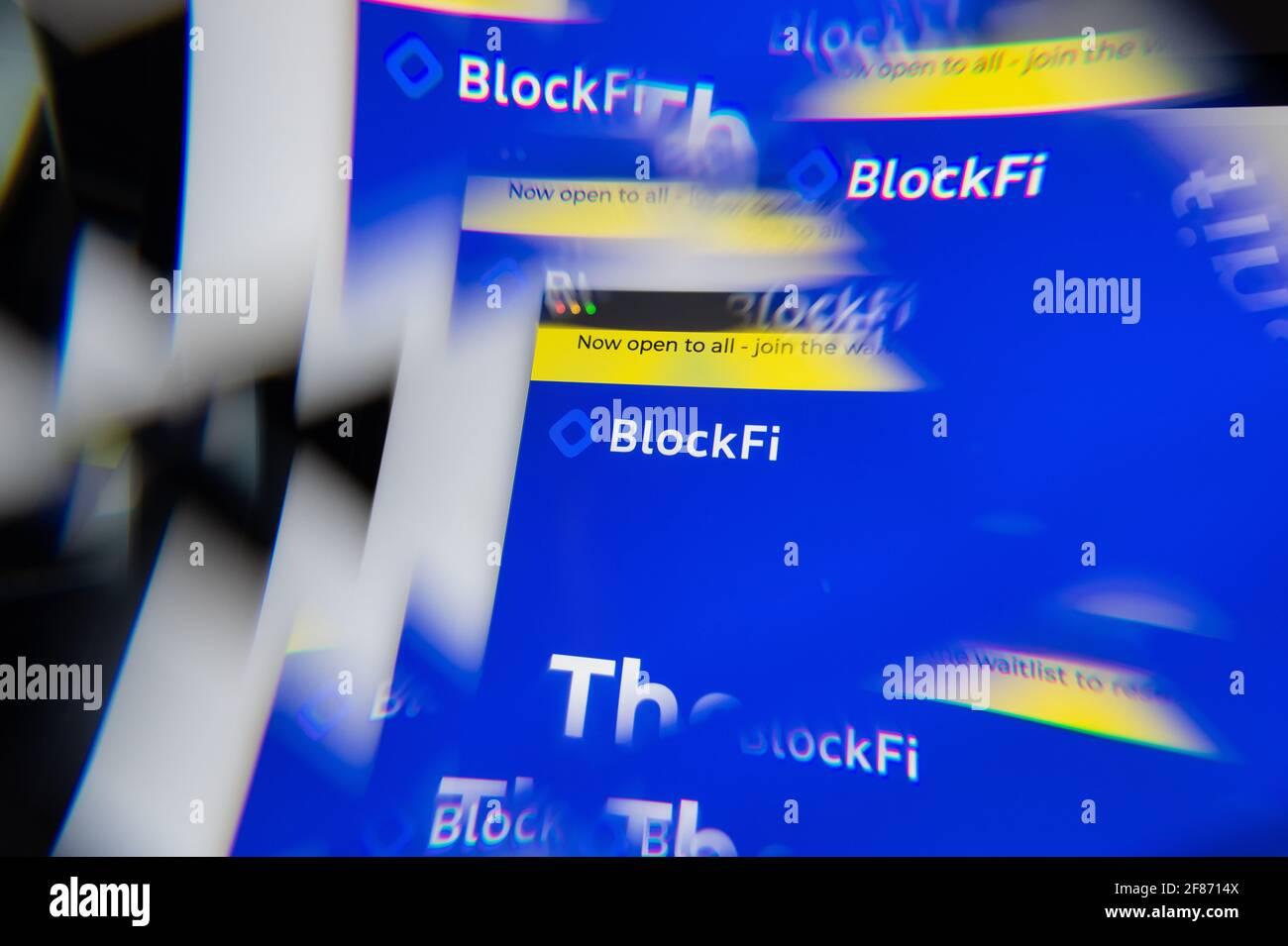 Milan, Italy - APRIL 10, 2021: BlockFi logo on laptop screen seen through an optical prism. Illustrative editorial image from BlockFi website. Stock Photo