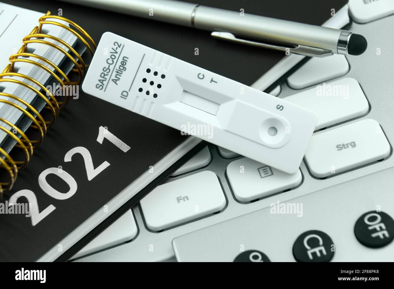 Corona Antigen Rapid Test and PC with calendar 2021 work station Stock Photo