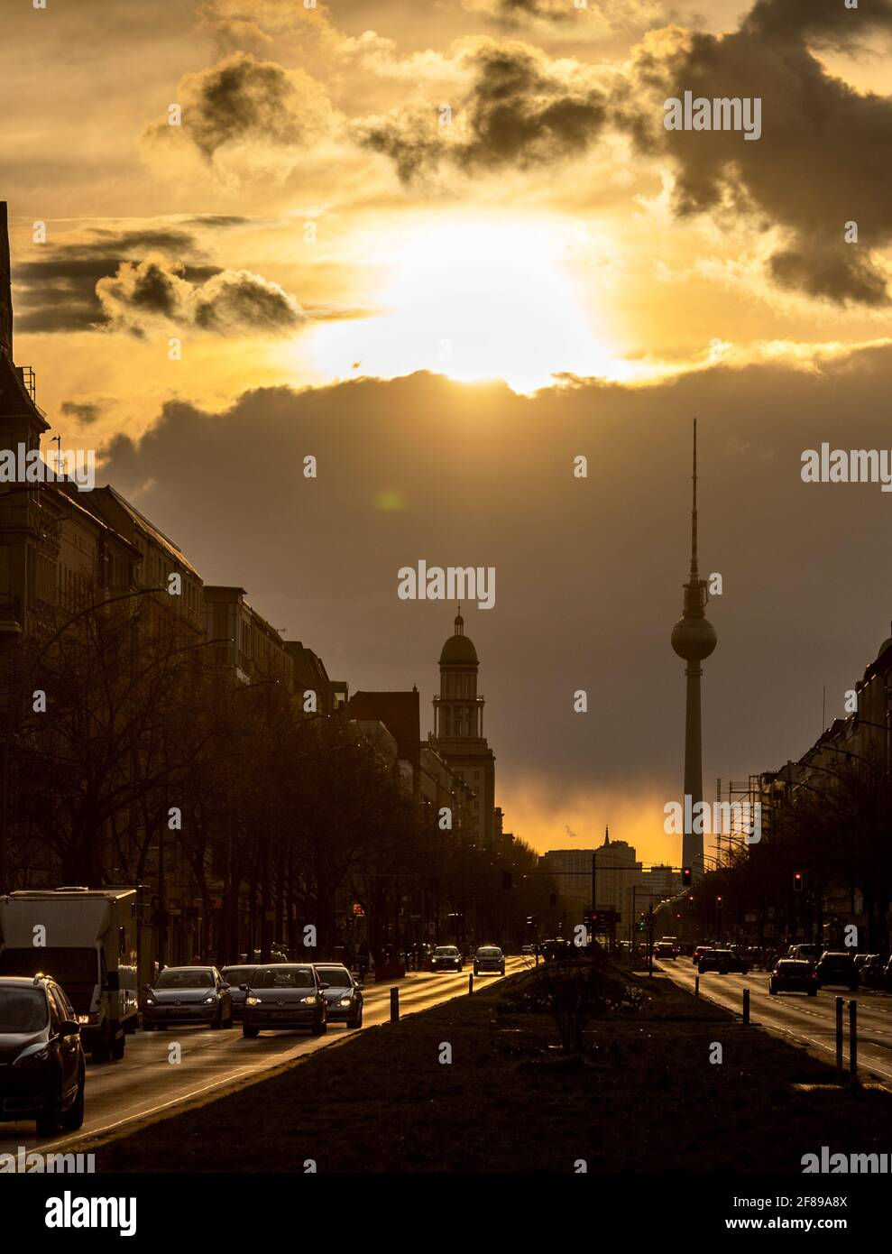 Berlin, Germany. 12th Apr, 2021. During sunset, a dark cloud moves behind the TV tower. Credit: Christophe Gateau/dpa/Alamy Live News Stock Photo