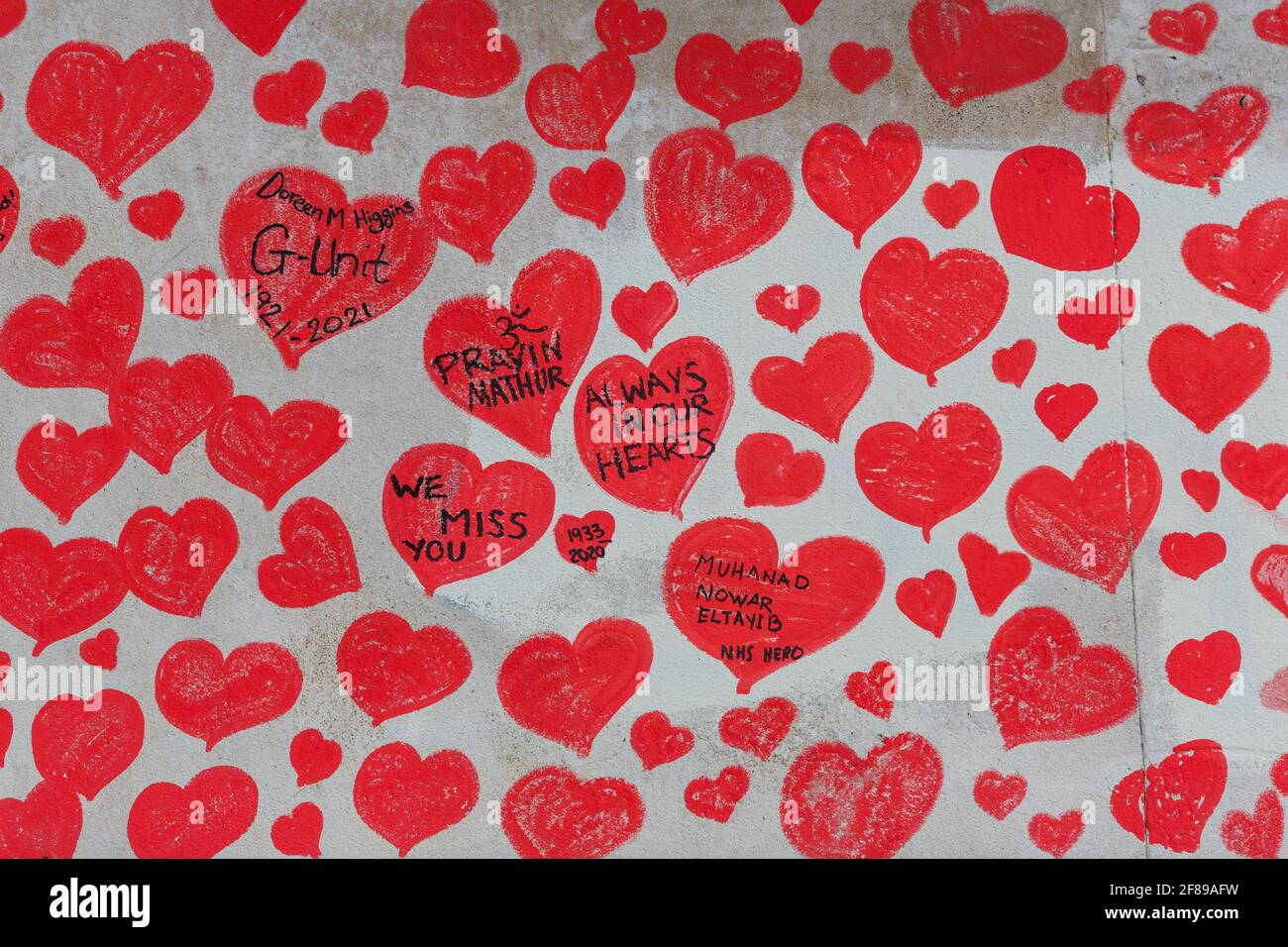 Red hearts painted on the National Covid Memorial Wall as a tribute to the British victims of the Coronavirus pandemic Stock Photo