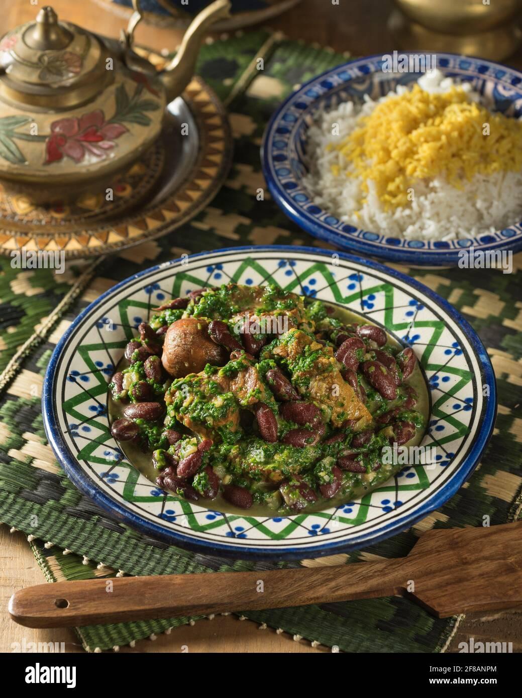 Khoresh ghormeh sabzi. Iranian lamb and herb stew. Iran Food Stock Photo