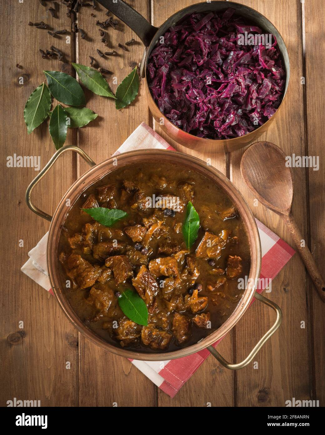 Hachee. Dutch beef and onion stew with red cabbage. Netherlands Food Stock Photo