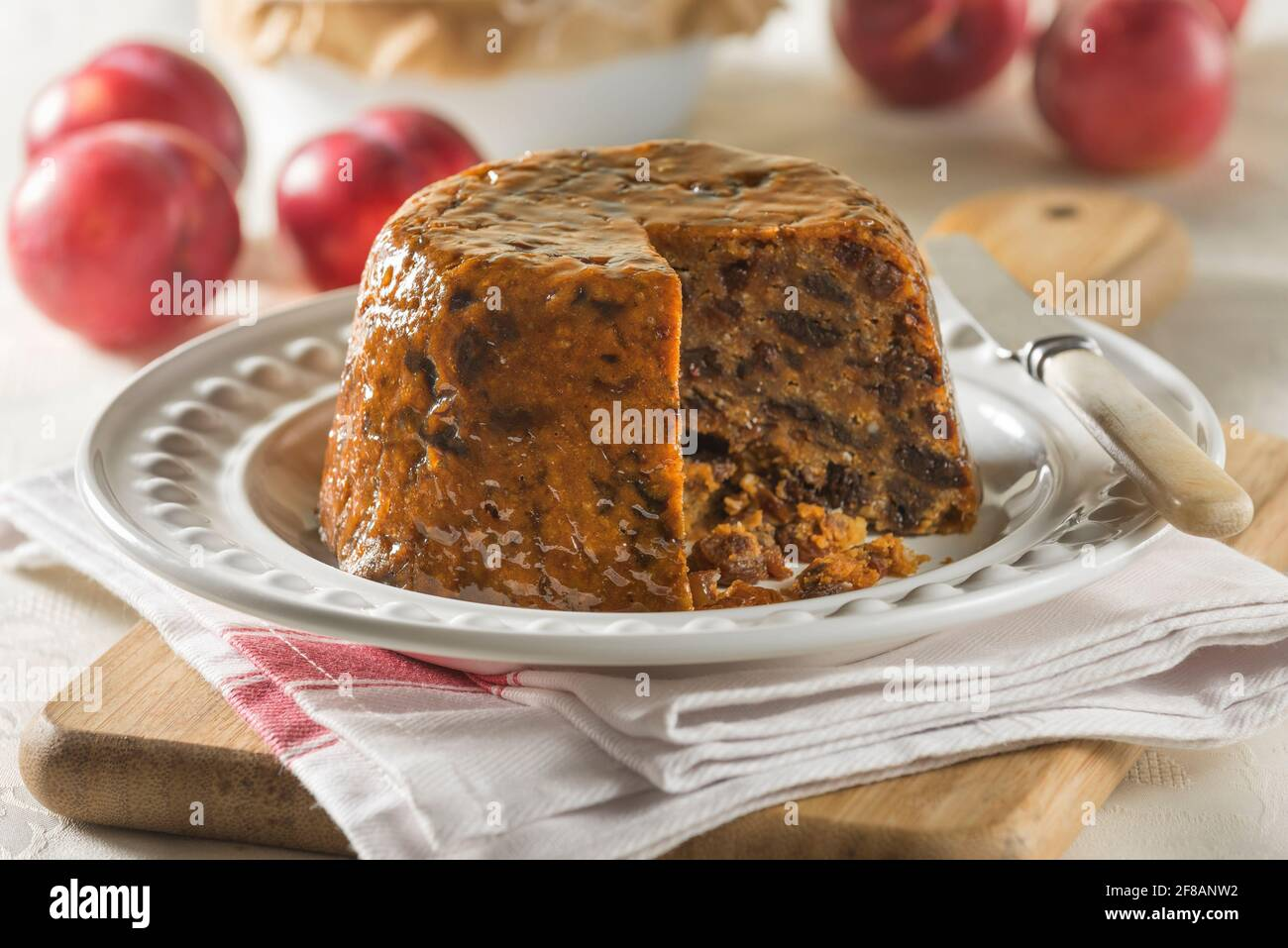 Plum duff. Steamed fruit pudding. Traditional food UK Stock Photo