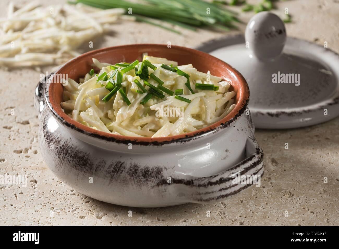 Celeriac remoulade. Celery root salad in mustard mayonnaise. Stock Photo