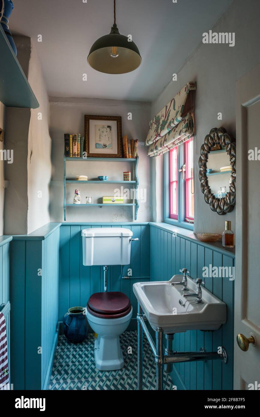 Small bathroom with turquoise dado panelling in Grade II listed Suffolk farmhouse Stock Photo