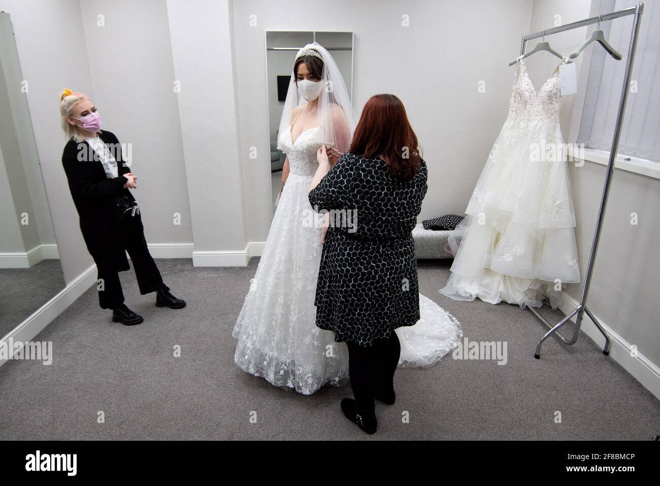 Bride-to-be Erin Barwell tries on dresses for the first time since non-essential retailers reopened this week. Erin, from Stoke-on-Trent, is due to get married next February and tried on dresses at Roberta's Bridal in Burslem, Stoke-on-Trent, following the further easing of lockdown restrictions in England. Picture date: Tuesday April 13, 2021. Stock Photo