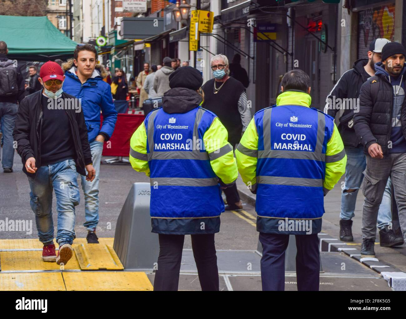 London, United Kingdom. 14th April 2021. Covid Marshals in Old Compton Street, Soho. Marshals have been deployed in the busy streets of Soho to support the public in observing the social distancing rules. Stock Photo