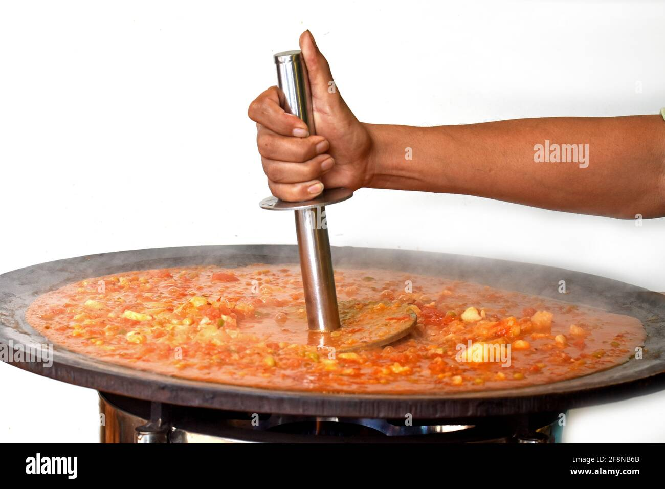 Pav Bhaji being cooked in the streets of India, Indian Mumbai food Pav bhaji, Pav Bhaji is a fast food dish, Thick and spicy vegetable curry, Stock Photo