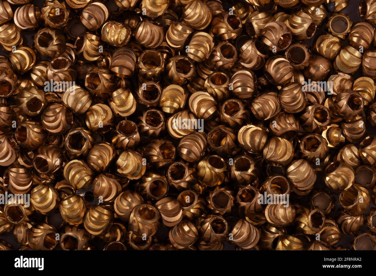 Golden beads close up background Stock Photo