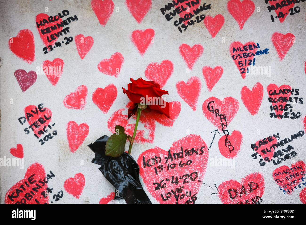 London, UK. 13 April 2021. The National COVID Memorial Wall - hand drawn red hearts on a wall opposite Houses of Parliament. Credit: Waldemar Sikora Stock Photo