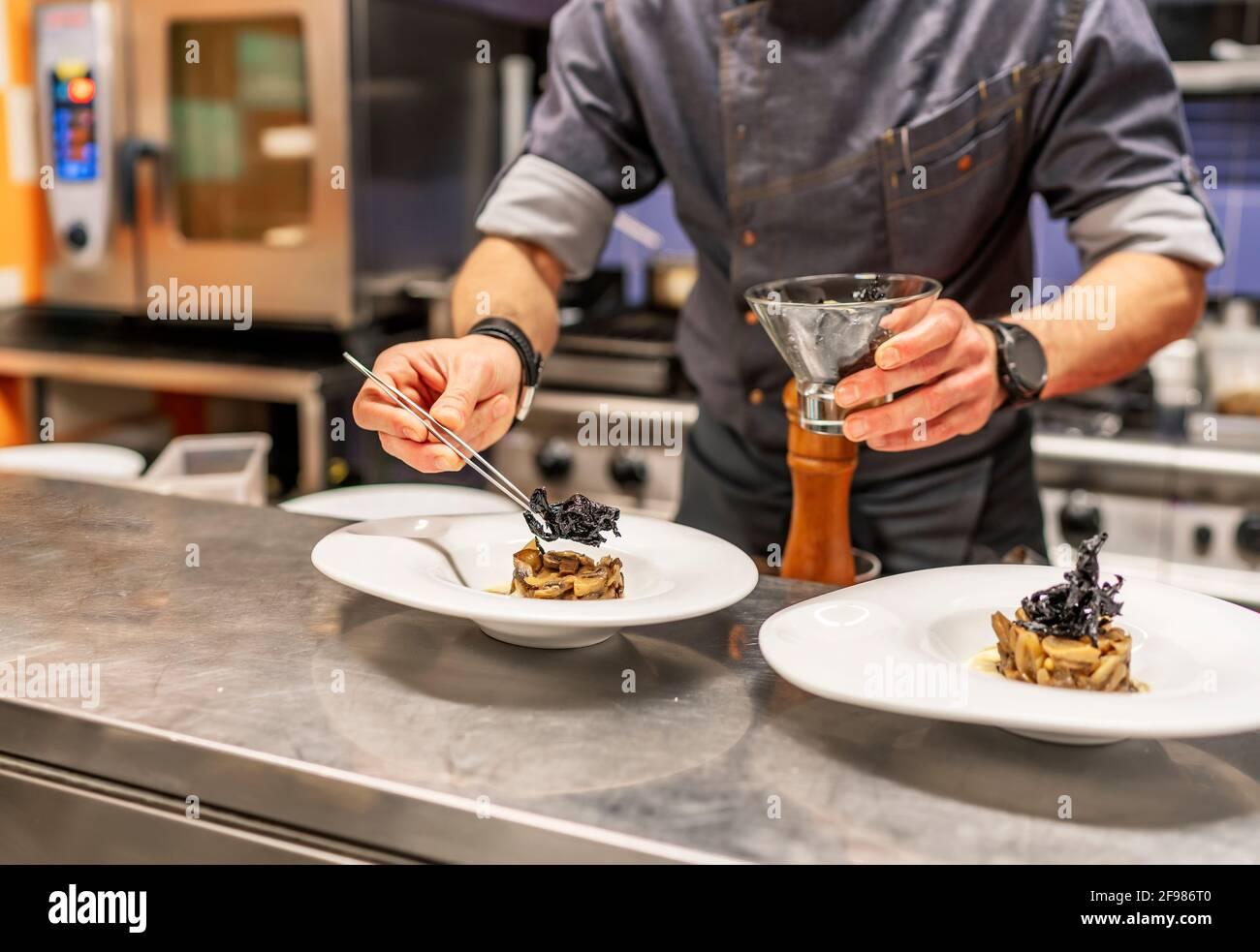 kitchen chef preparing a delicate dish Stock Photo