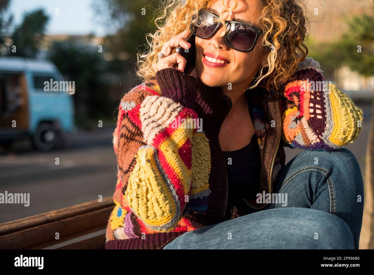 Portrait of cheerful happy beautiful woman doing phone call in sunny day outdoor leisure travel activity alone - concept of joyful pretty female in summer spring lifestyle smiling Stock Photo