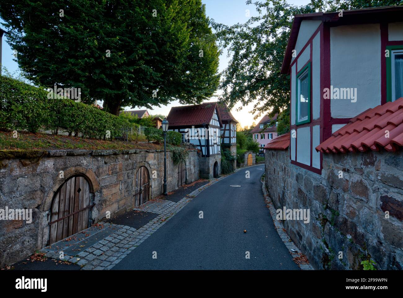 City wall, city fortifications, cellar house, facade, half-timbered, alley, architecture, Haßberge, Ebern, Franconia, Bavaria, Germany, Europe Stock Photo