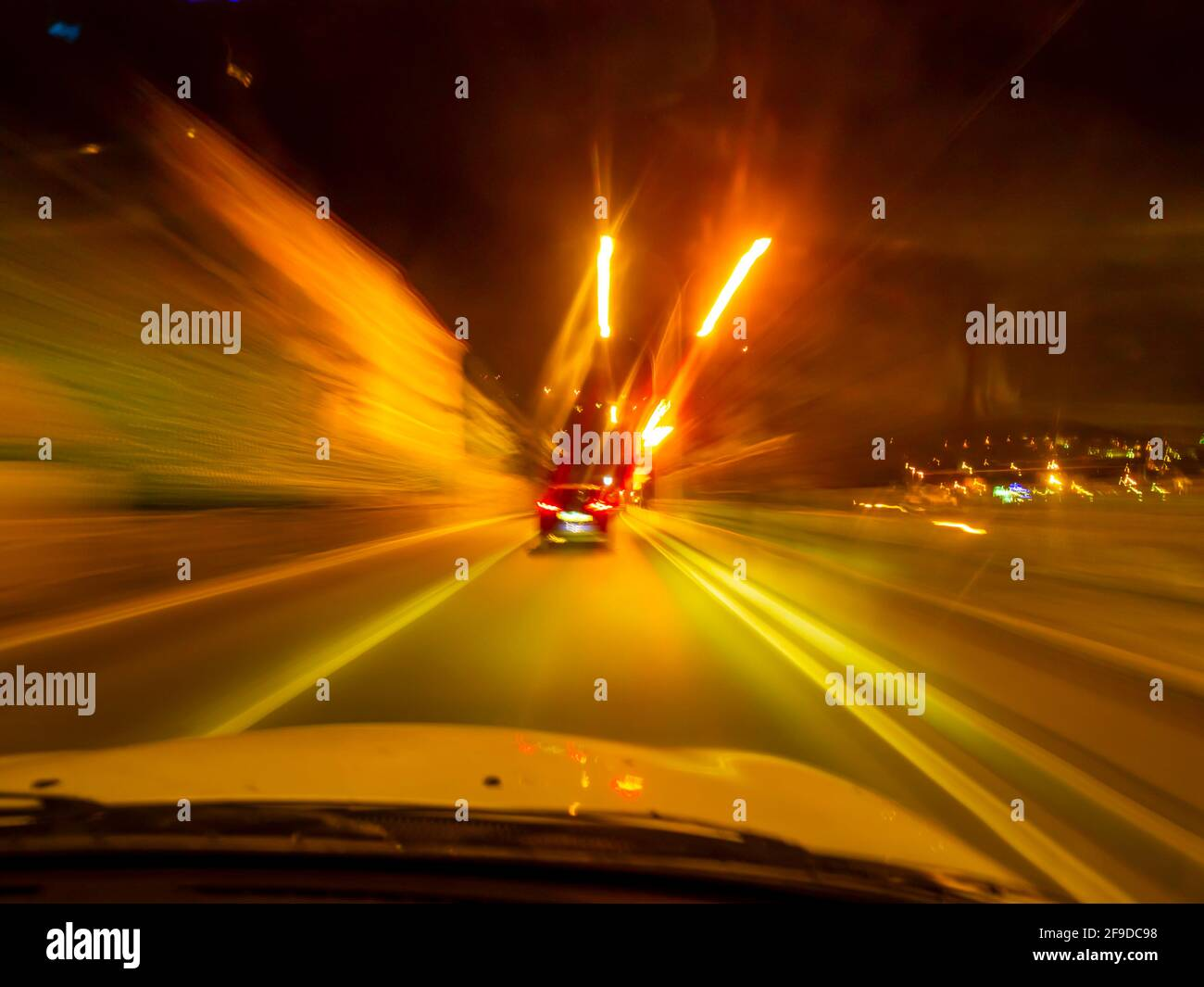 Intentionally blurry blur diminishing lines frantic furious driving warm warmth Red Yellow Orange vivid intensive colors Stock Photo
