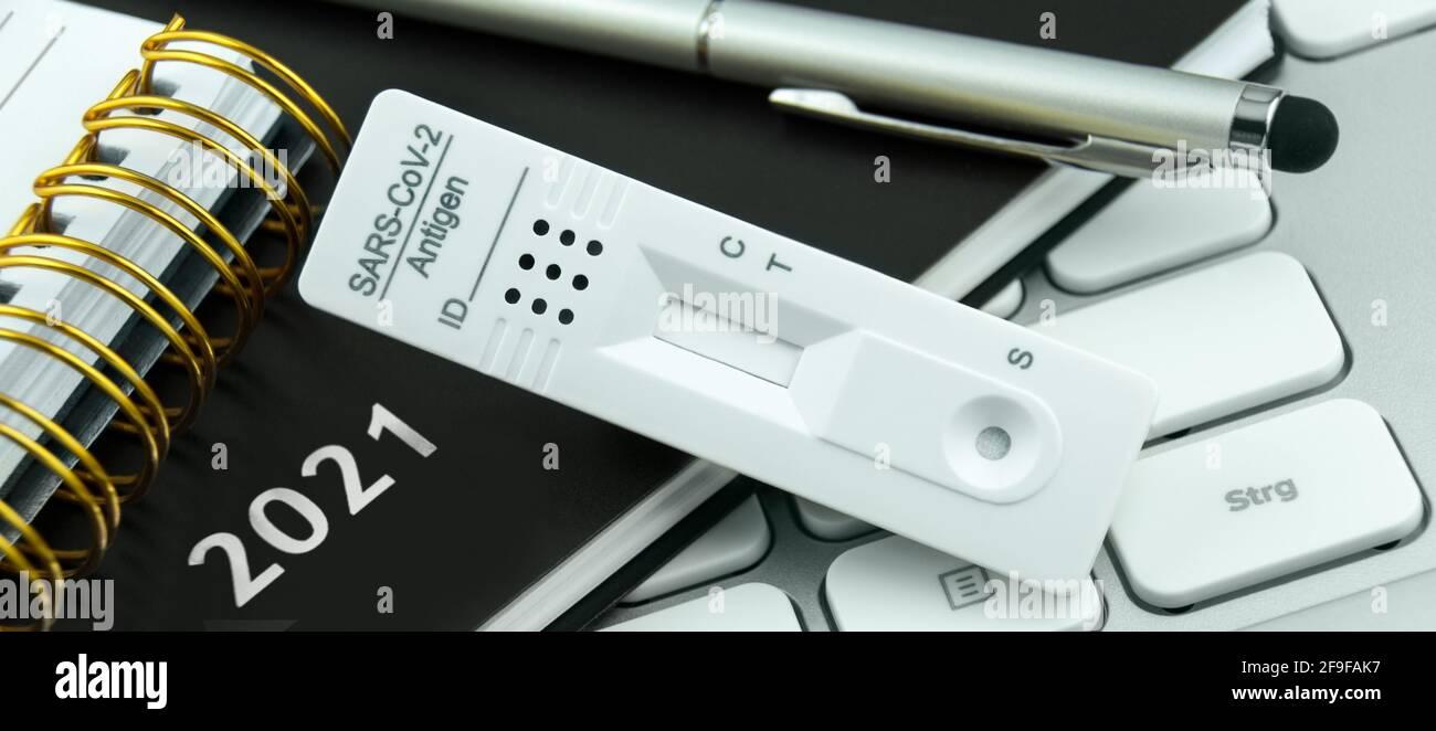 Corona Antigen Rapid Test and PC with calendar 2021 Stock Photo