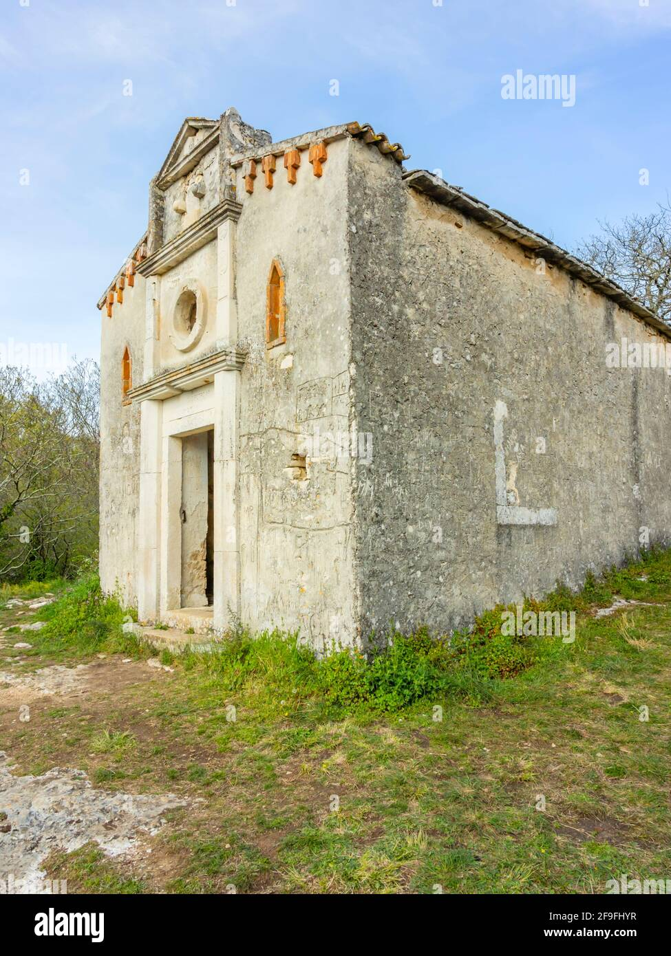 Exterior of Church St Saint Peter on peak crkva Svetog Petra apostola na vrhu on rock between Krancici and Bale in Istria in Croatia Europe Stock Photo