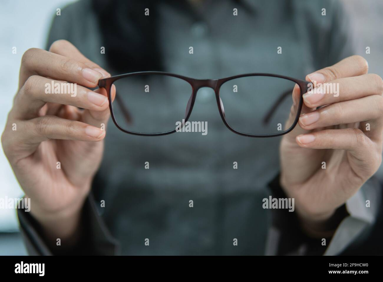 a beautiful woman holding a sample of glasses Stock Photo