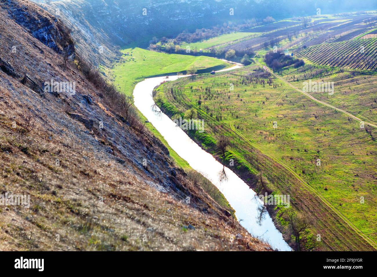 Green mountain valley with river . Panoramic view of riverside fields Stock Photo