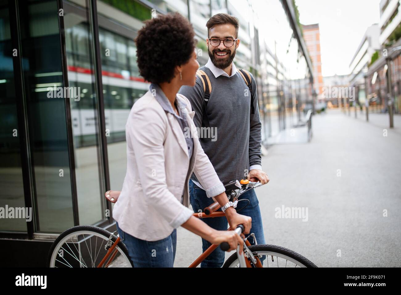 Young couple having fun in the city and ride a bicycle Stock Photo