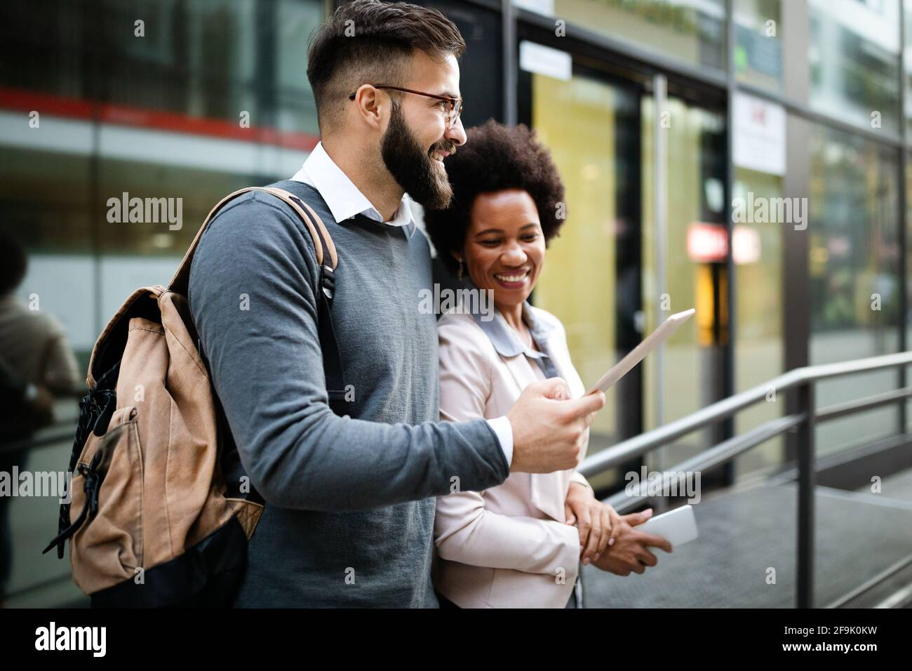 Happy business people, students having fun, smiling, talking in the city Stock Photo