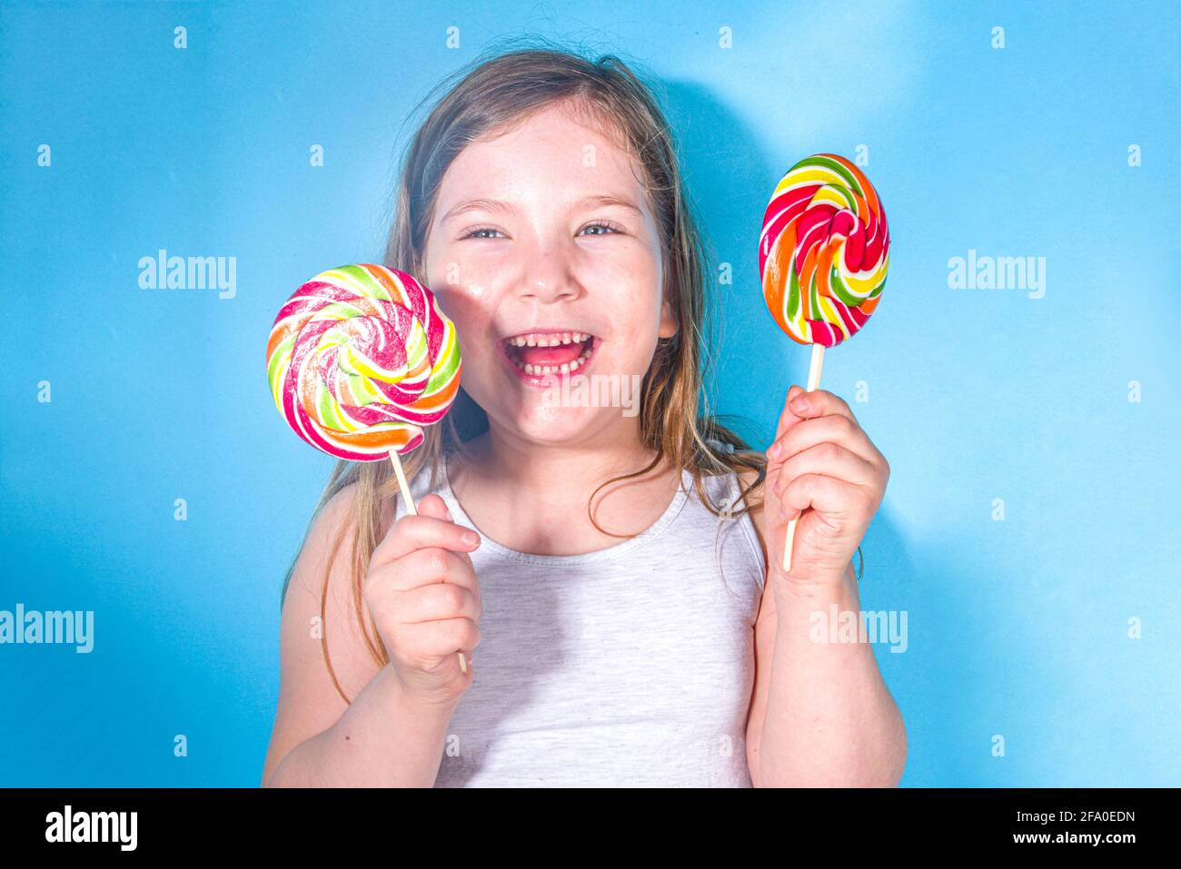 Little happy funny girl with big colorful lollypops, Holiday, happiness, summer vacation concept, Stock Photo