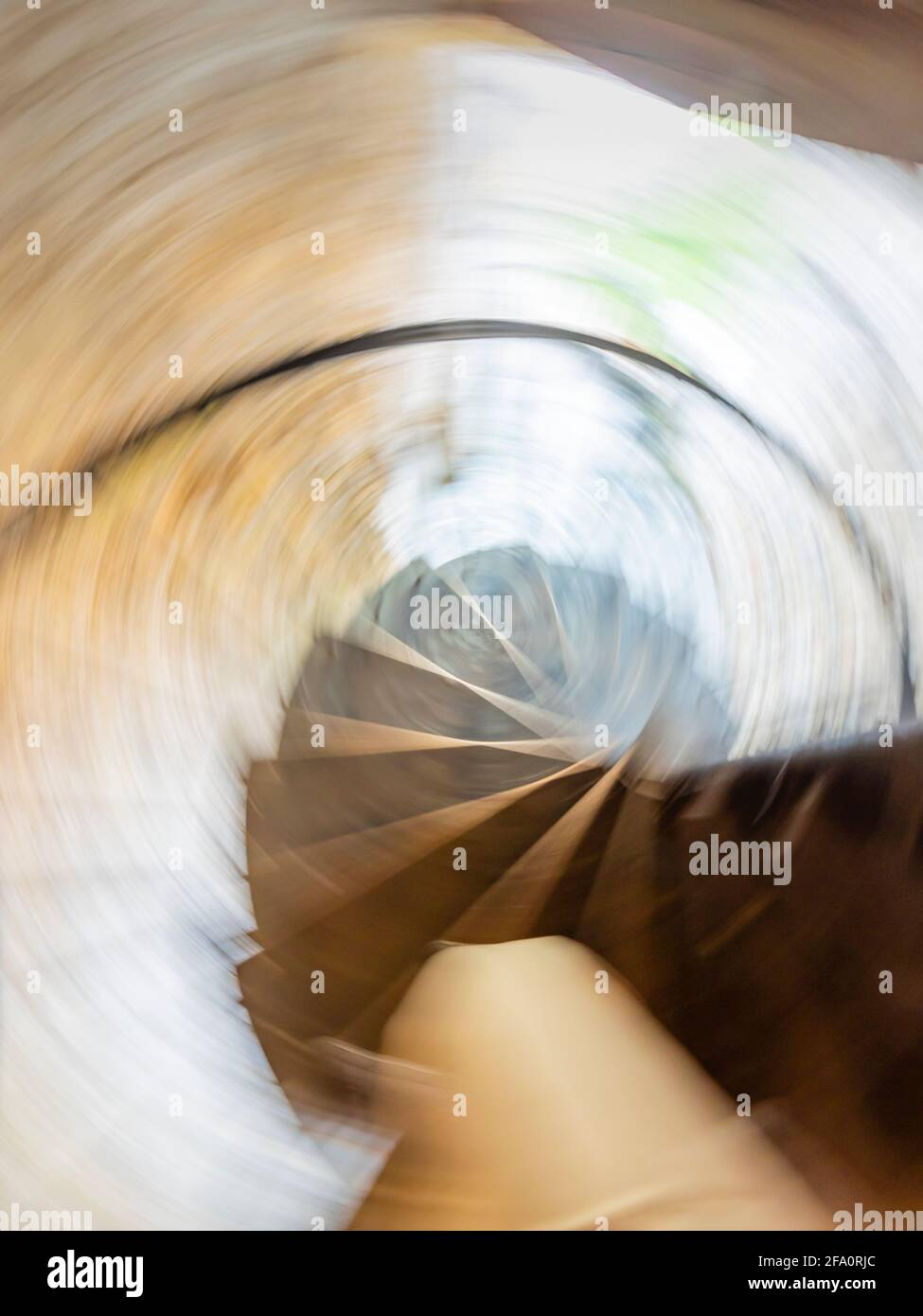 Frantic run downstairs downwards circular staircase frenetic intentionally blurry running down Stock Photo