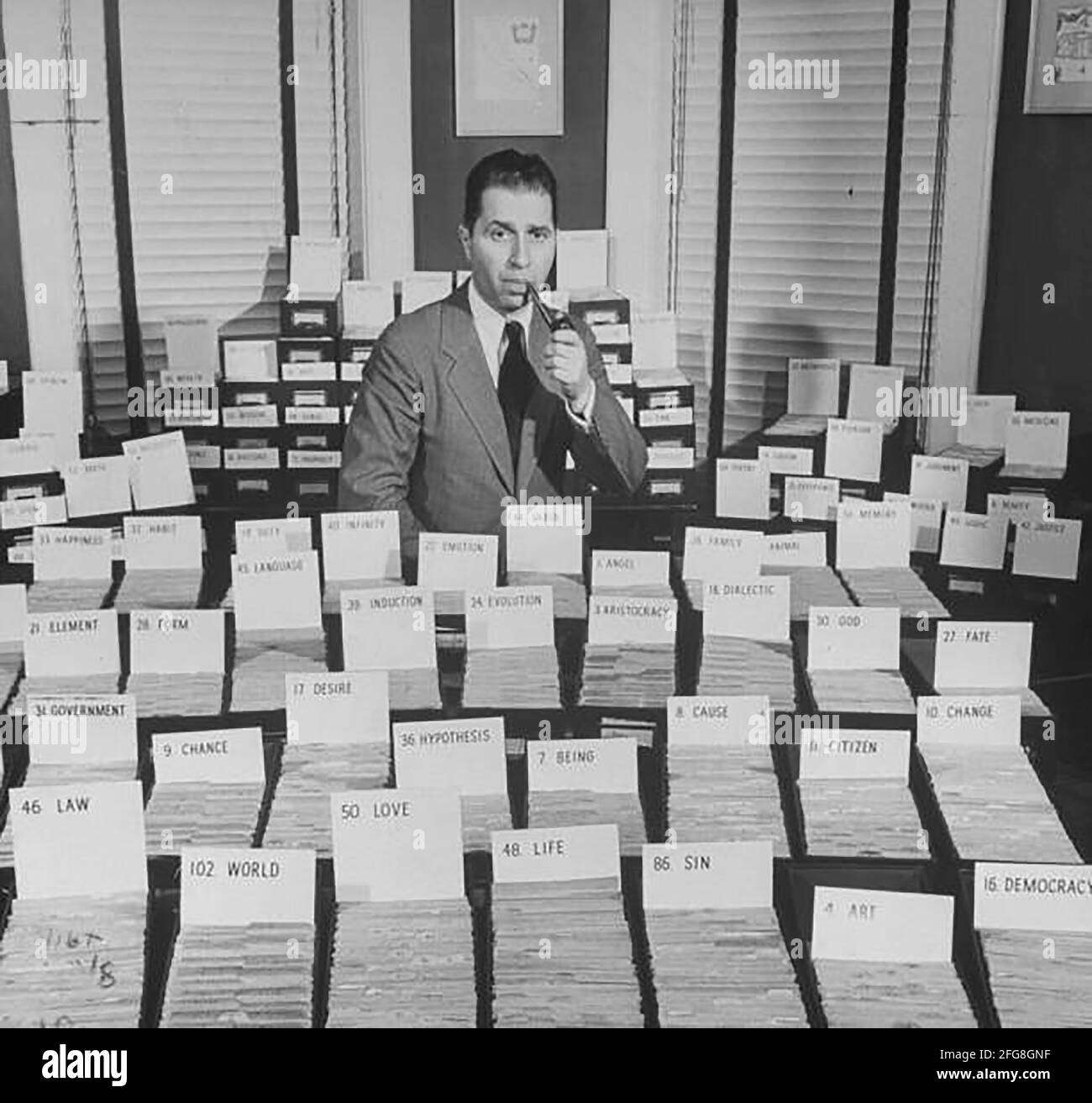 Mortimer J. Adler surrounded by his great ideas.  (Photo by George Skadding/The LIFE Picture Collection via Getty Images) Stock Photo