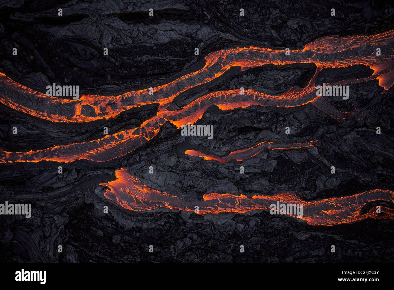 Rough terrain with flowing hot lava Stock Photo