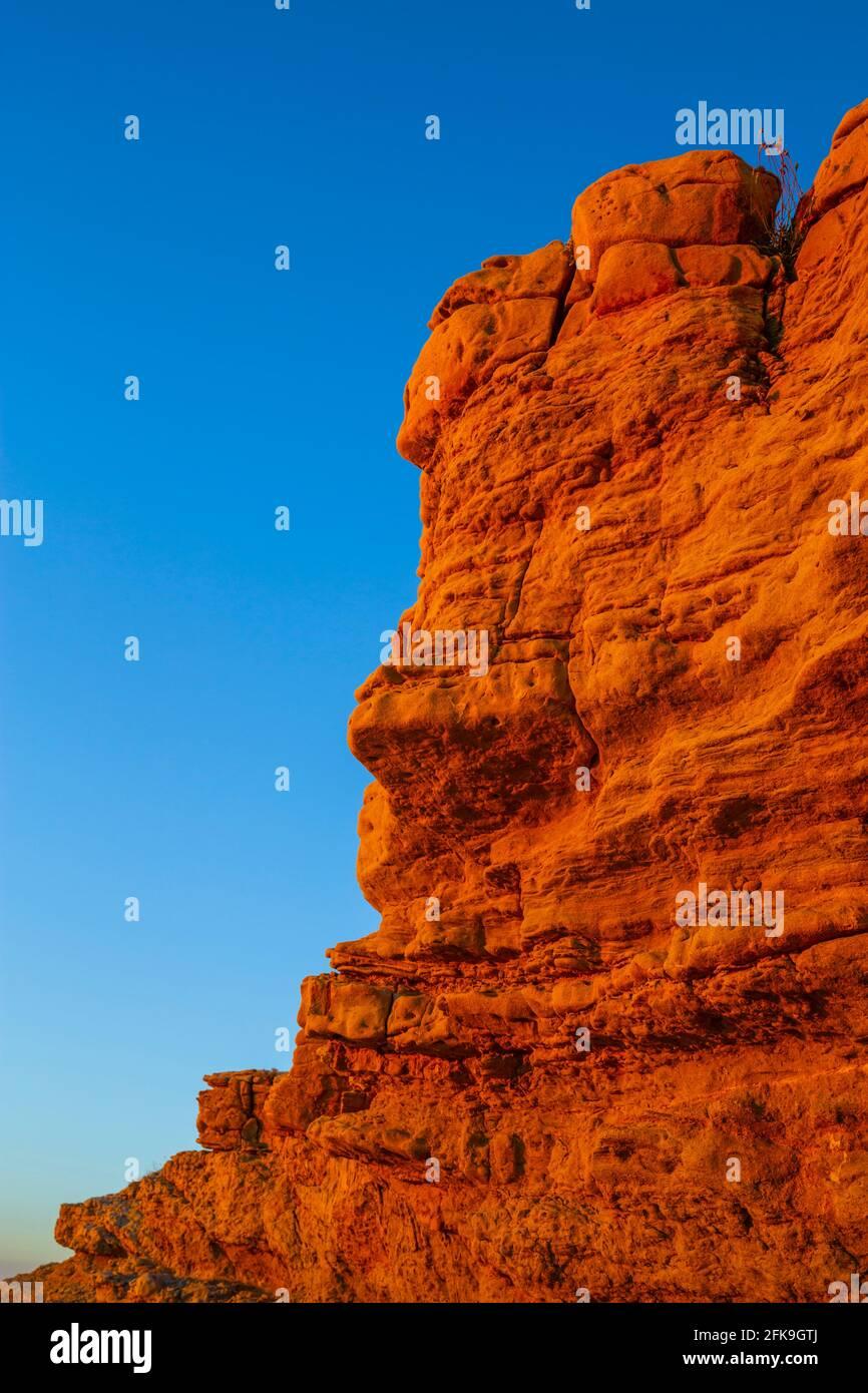 Lopar on Rab island sunset evening wilderness intensive vivid bright Orange-Yellow sharp edge slab Stock Photo