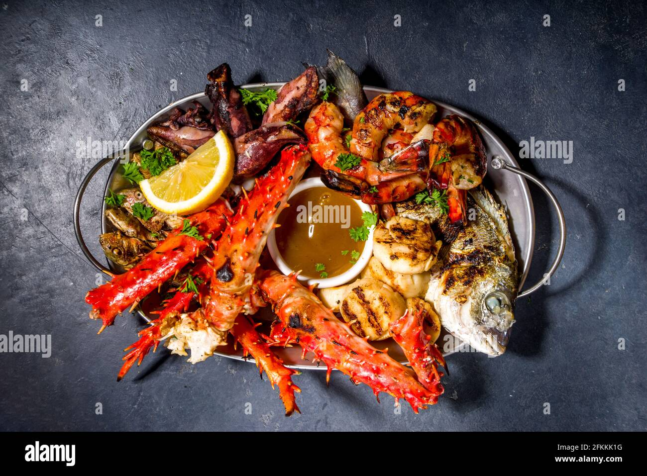 Assortment various barbecue Mediterranean grill food - fish, octopus, shrimp, crab, seafood, mussels, summer diet bbq party fest, with kebab, sauces, Stock Photo