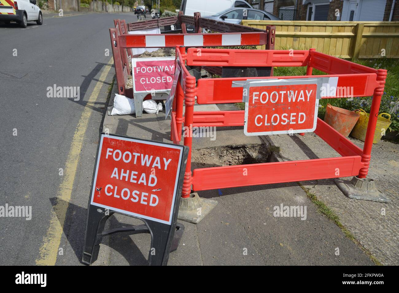 Maidstone, Kent, UK. Footway Closed signs at a caved-in pavement Stock Photo