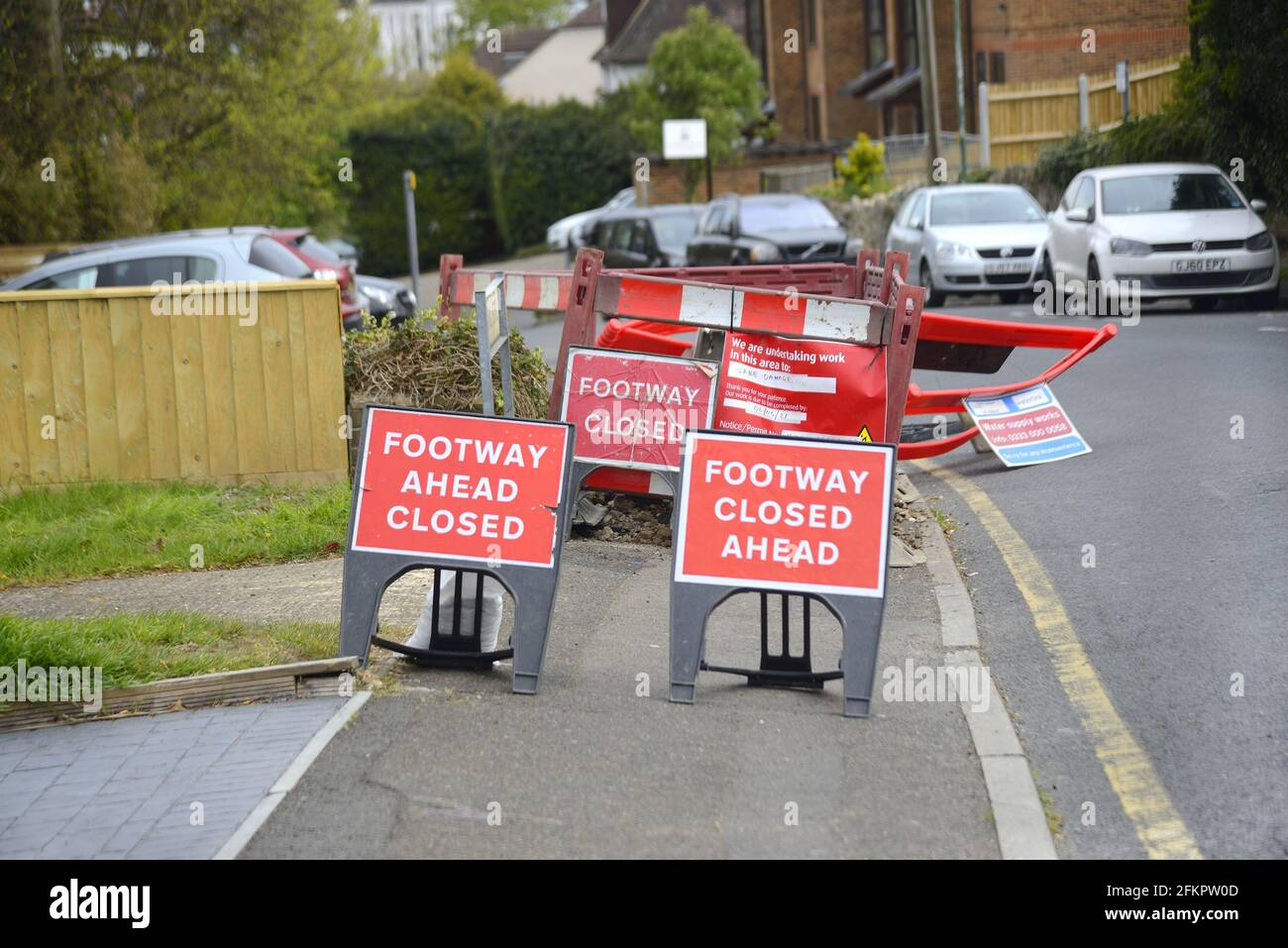 Maidstone, Kent, UK. 3 different Footpath Closed signs at a caved-in pavement Stock Photo