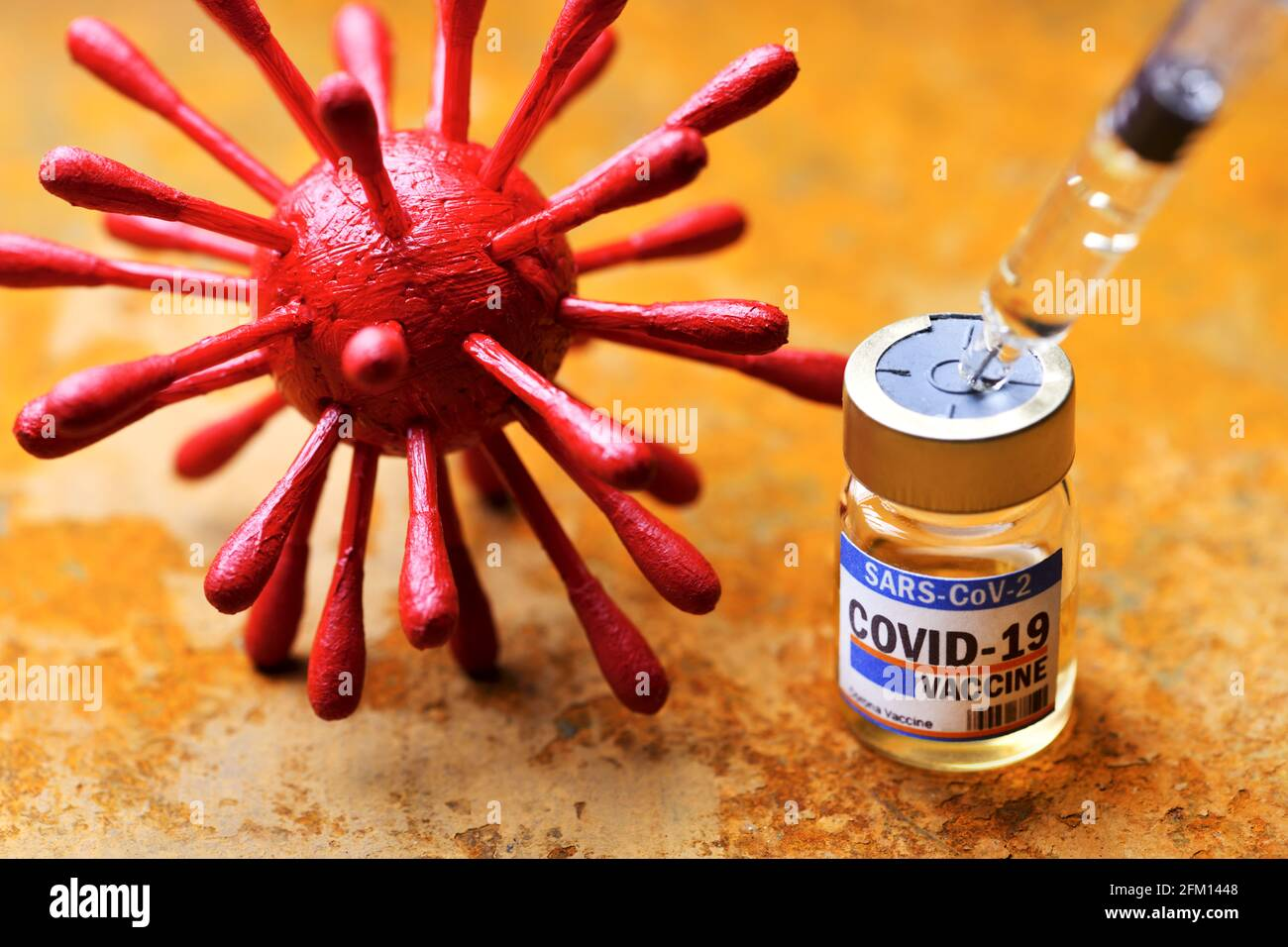 Vaccine Vial, Syringe And Coronavirus Model, Covid Vaccination Stock Photo