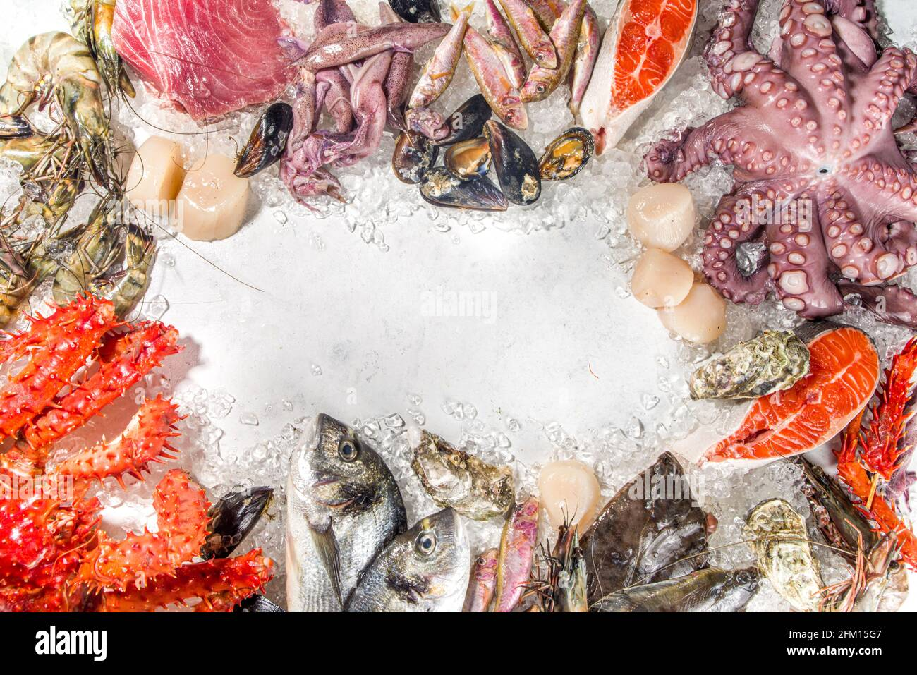 Set of various fresh raw seafood - octopus, crab, squid, shrimp prawn, oyster, mussels, salmon tuna dorada fish with spices of herbs lemon, white back Stock Photo