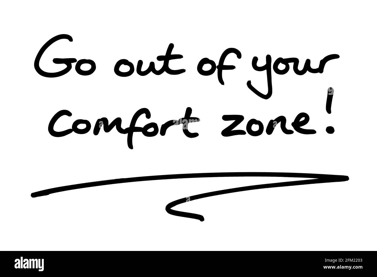 Go out of your comfort zone! handwritten on a white background. Stock Photo