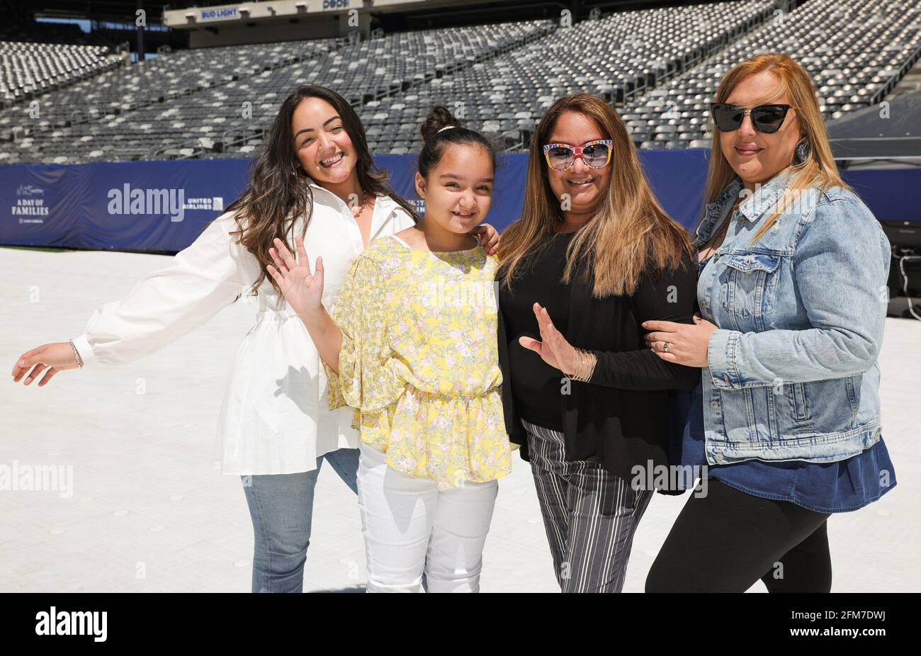 East Rutherford, NJ, USA. 6th May, 2021. Family reunion Photo Call for CLEAR Brings Together Over 100 Family Members Separated During COVID to Reunite for the First Time, MetLife Stadium, East Rutherford, NJ May 6, 2021. Credit: CJ Rivera/Everett Collection/Alamy Live News Stock Photo