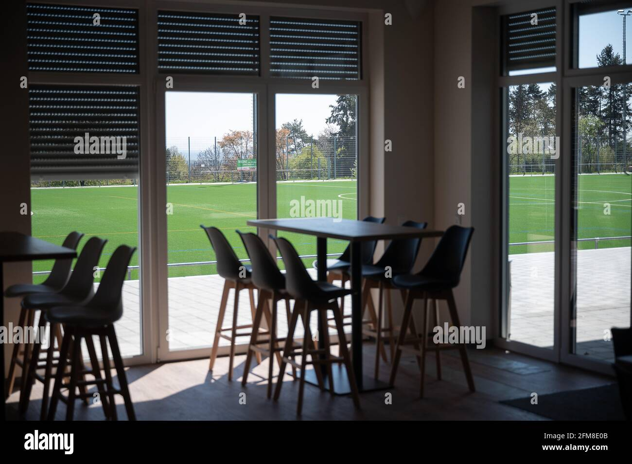 Kronberg Im Taunus, Germany. 25th Apr, 2021. Shutters are lowered at the SG Oberhöchstadt clubhouse. Credit: Sebastian Gollnow/dpa/Alamy Live News Stock Photo