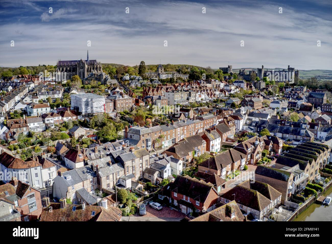 Aerial photo of Arundel Cathedral and Castle in the old historic town of Arundel in Southern England on the banks of the River Arun. Stock Photo