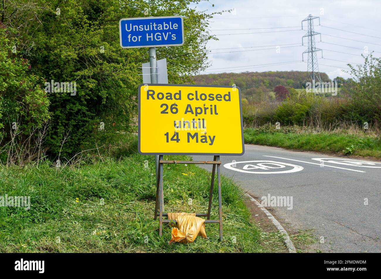 Aylesbury Vale, Buckinghamshire, UK. 29th April, 2021. HS2 have closed Rocky Road until 14th May 2021 for more work on the construction of the High Speed Rail from London to Birmingham. HS2 Security are stopping traffic and HS2 CCTV cameras are being used by HS2. HS2 have also closed a number of local footpaths including the bridleway from Rocky Lane to Durham Farm, however, none of the footpath closures are listed by Buckinghamshire Council on their website. Credit: Maureen McLean/Alamy Stock Photo