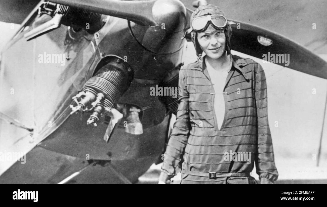 """AMELIA EARHART (1897-1937) Pioneer American aviator in Newfoundland with her bi-plane """"Friendship"""" in June 1928 prior to her record breaking flight across the America and back again. Stock Photo"""