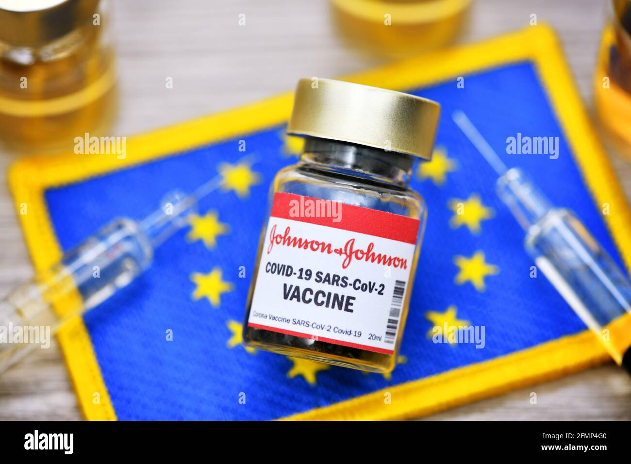 Covid Vaccine Of Johnson And Johnson In Front Of EU Flag, Symbolic Image Stock Photo