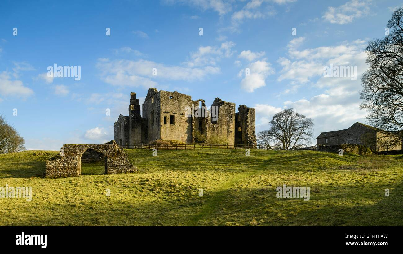 Barden Tower (sunlight on beautiful historic ancient ruin, stone arch & blue sky) - scenic rural Bolton Abbey Estate, Yorkshire Dales, England UK. Stock Photo
