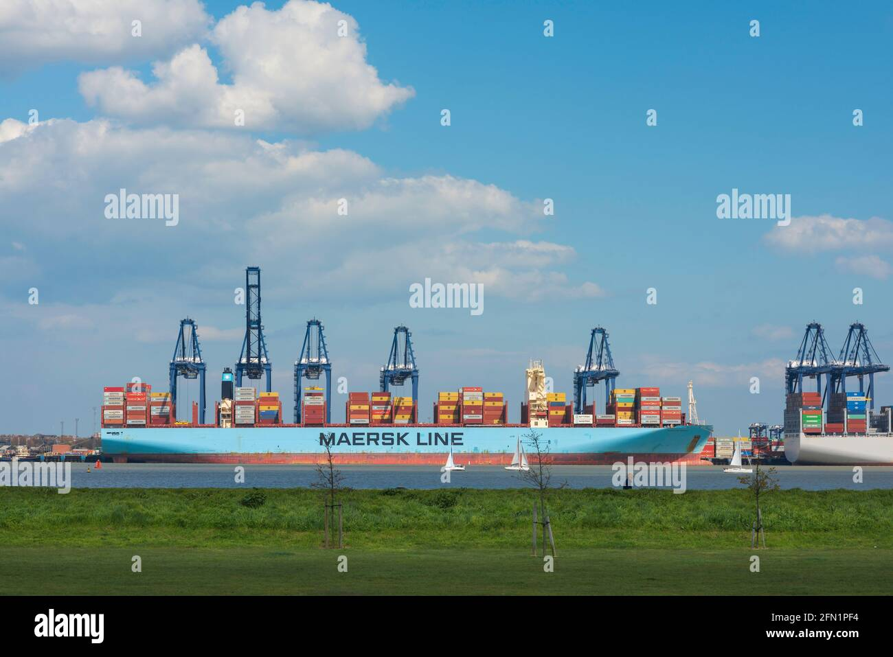 Container ship, view from Harwich across the River Stour towards a container ship being unloaded at Felixstowe docks in Suffolk, England, UK Stock Photo