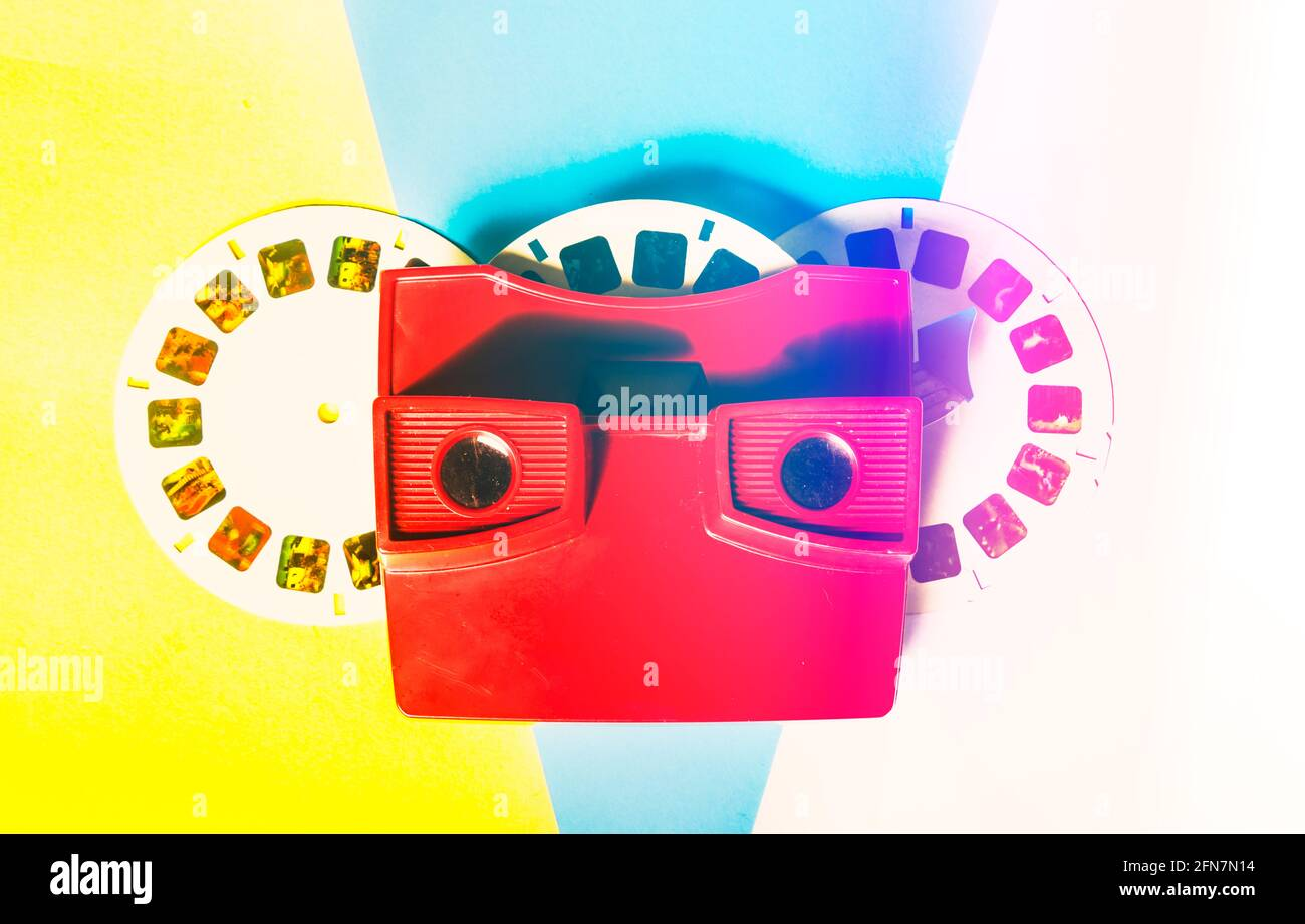 Flared pop art still on an antique slide viewer seen in a colorful faded flashback. Retro reel Stock Photo