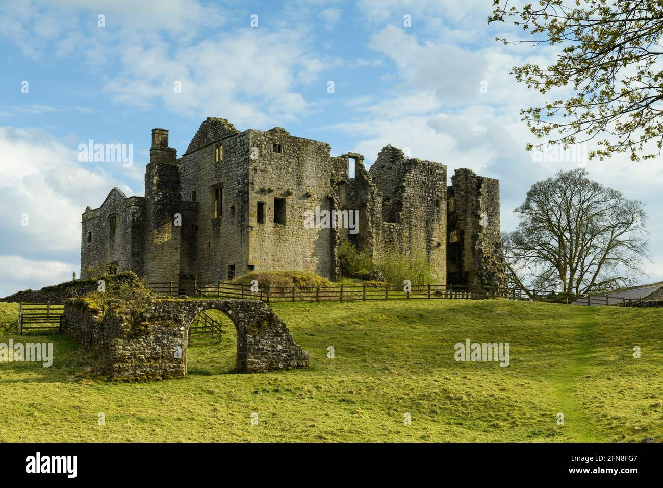 Barden Tower (sunlight on beautiful historic ancient hunting lodge ruin & blue sky) - scenic rural Bolton Abbey Estate, Yorkshire Dales, England UK. Stock Photo