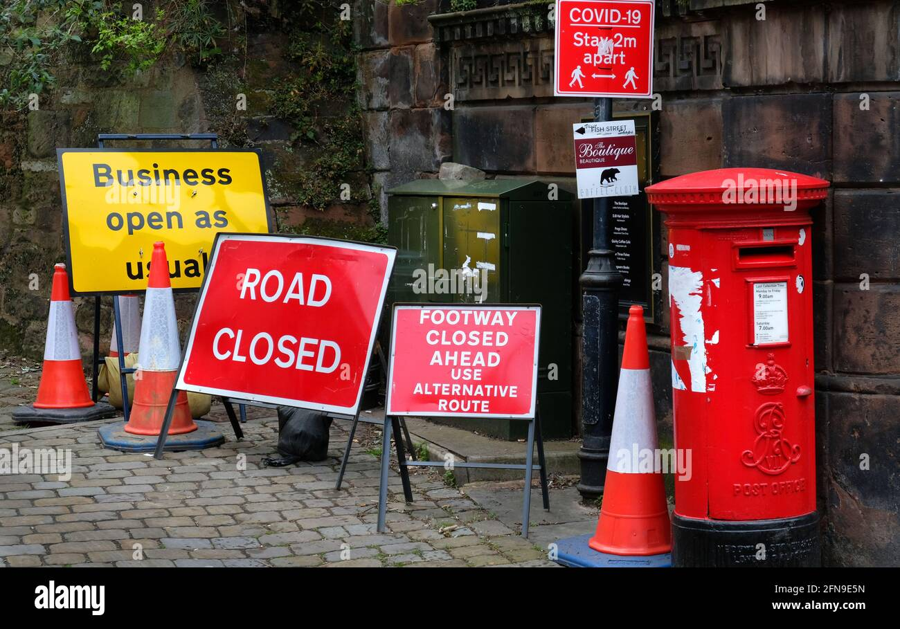 Too many road signs and a red letterbox at the corner of Fish Street and Wyle Cop, Shrewsbury, Shropshire, England, UK Stock Photo