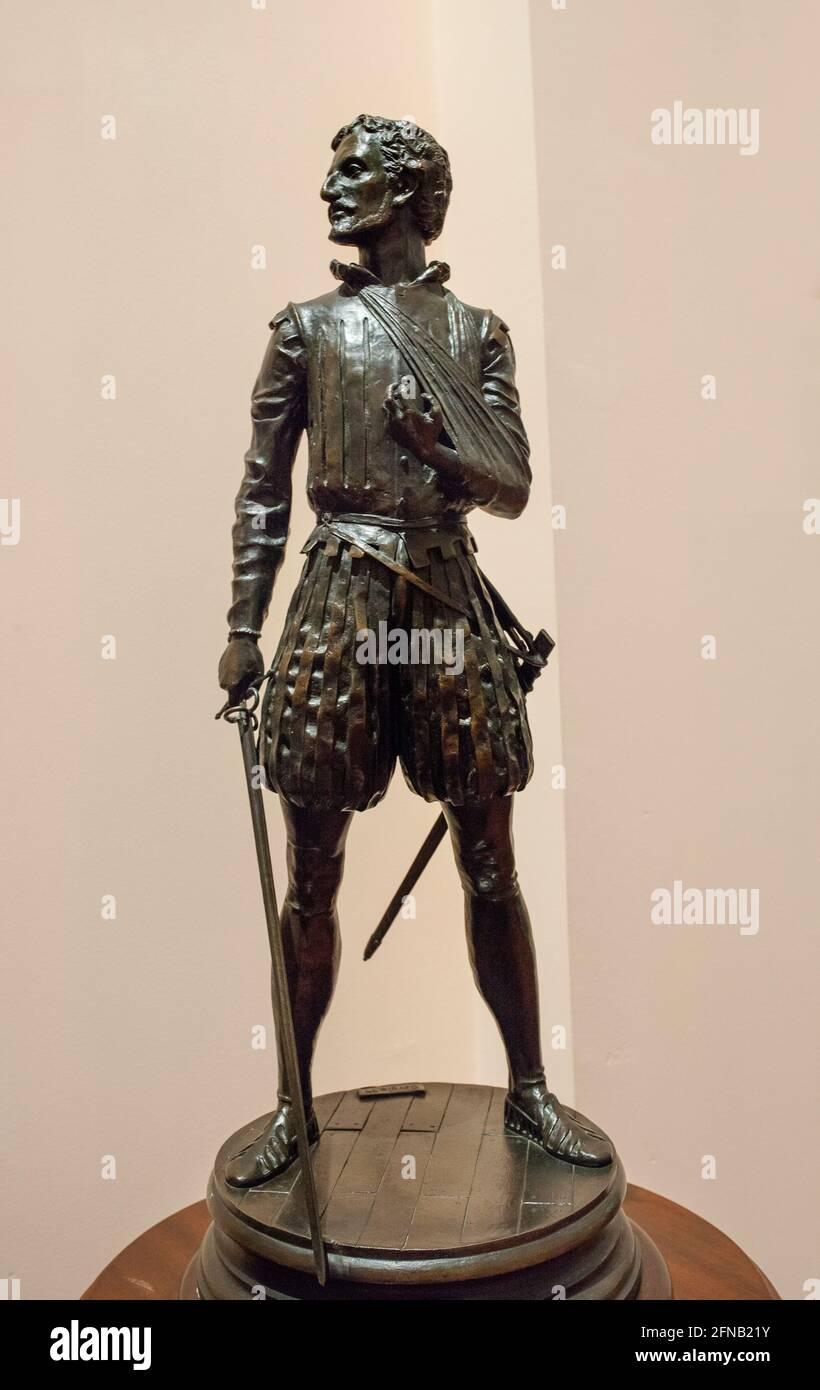 Miguel de Cervantes Saavedra statuette, depicted as Battle of Lepanto soldier. By Sergio Blanco, 1999. Museo Naval de Stock Photo