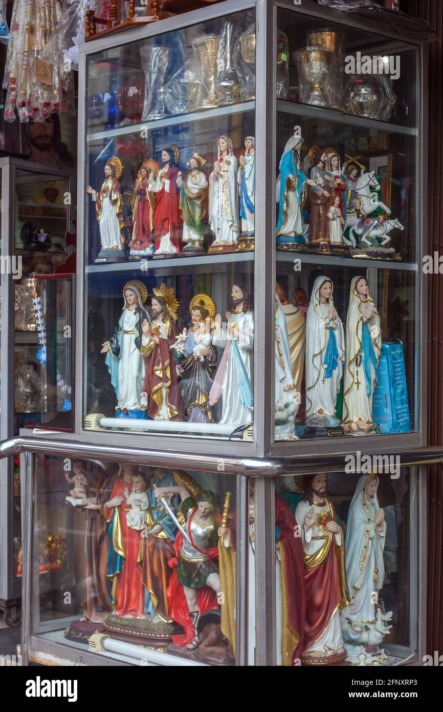 Glass display cabinet outside shop containing Jesus, Mary and ...