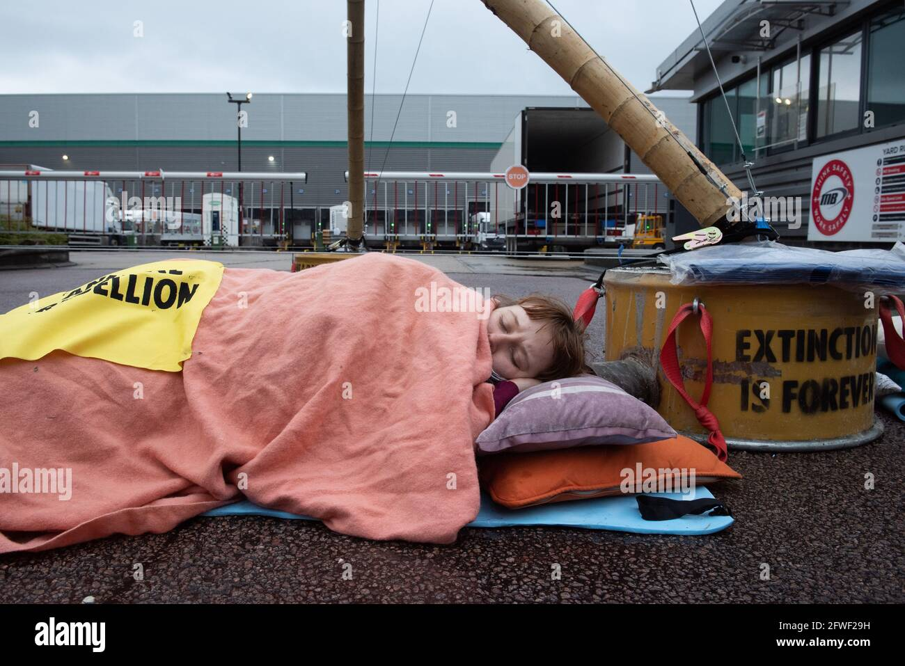 Hemel Hempstead, UK. 22.05.21 - Animal Rights activists blocked all 4 of McDonalds UK distribution centres. They view McDonalds as a symbol of industrial animal agriculture which contributes to the climate crisis as well as causing suffering to animals. Credit: Gareth Morris/Alamy Live News Stock Photo