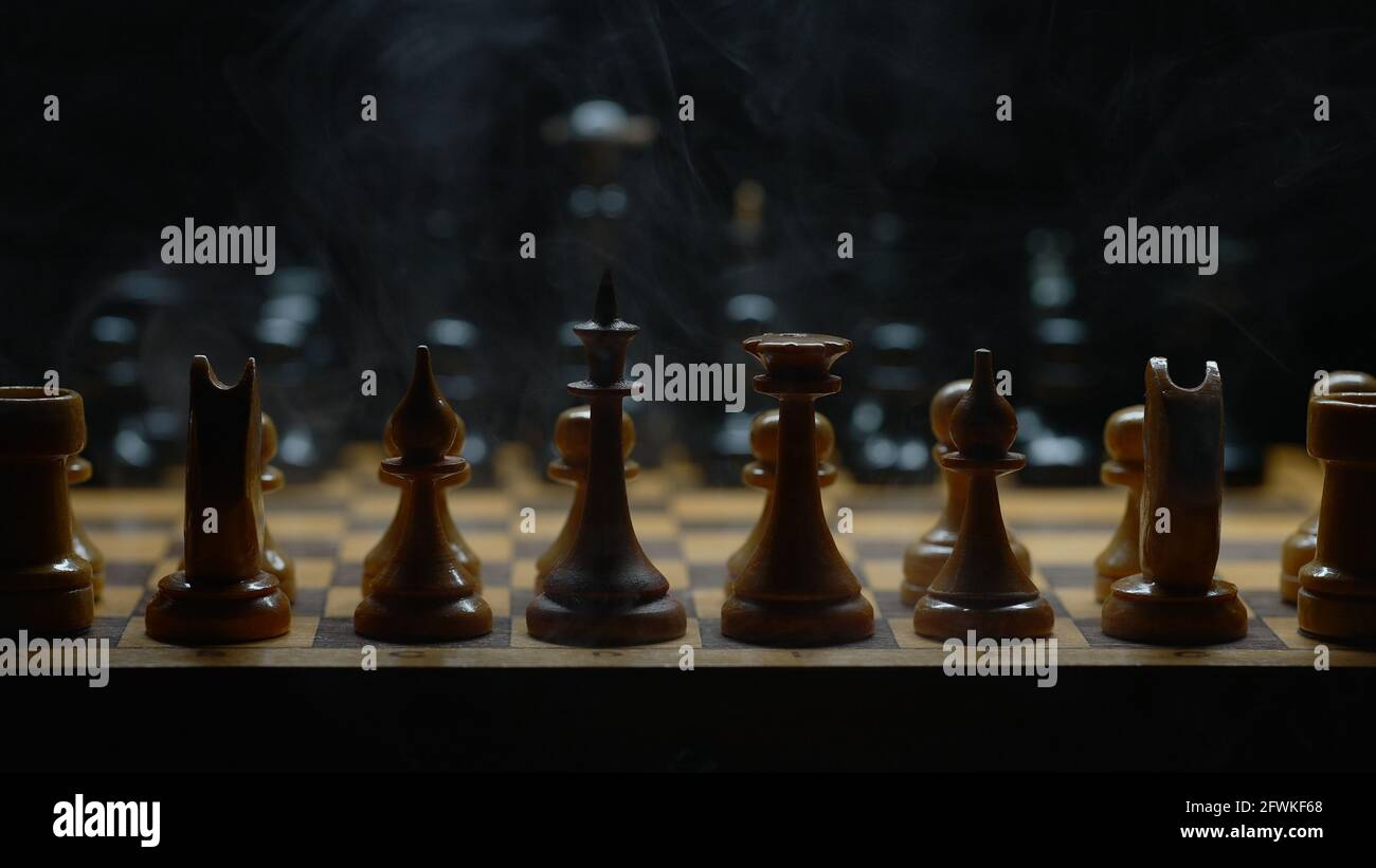 Illuminated chess with smoke effect. Suitable for commercials. Stock Photo